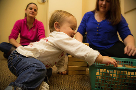 A child, parent and graduate student clinician participate in the Thayer Lindsley Program